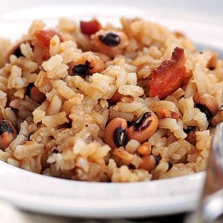 Hoppin John is a traditional southern New Year's Day dish made of black-eyed peas and rice, accented with pork.