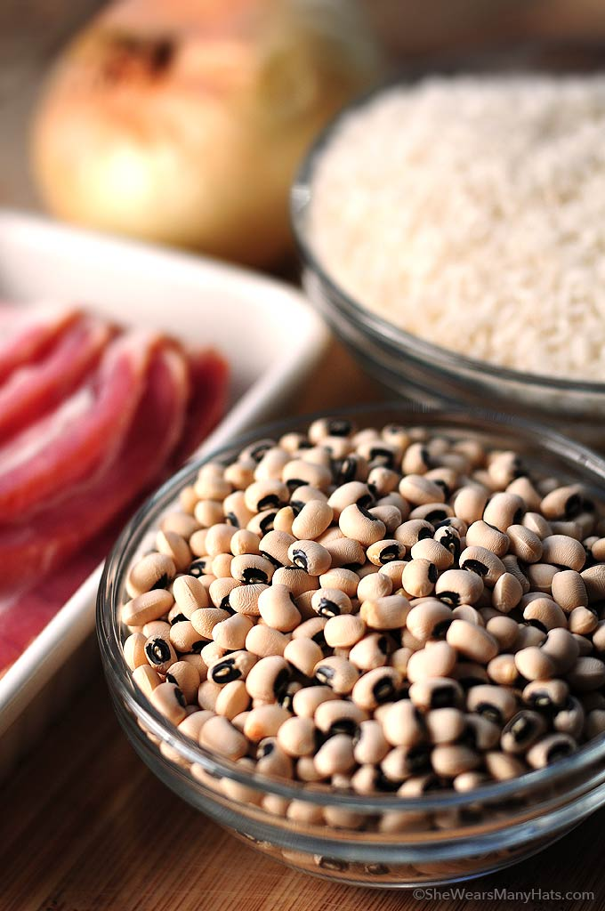Hoppin John is a traditional southern New Year's Day dish made of black-eyed peas and rice, accented with pork. | shewearsmanyhats.com