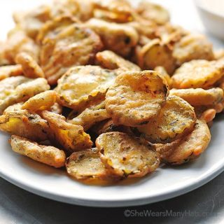 golden brown fried pickles on a plate