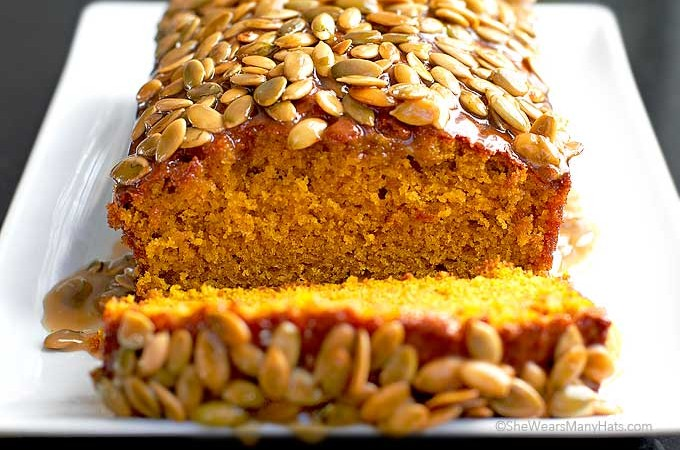 This Pumpkin Bread topped with Pumpkin Praline Topping is spiced with warm cinnamon and ginger will have your home smelling so good! This easy recipe makes 2 loaves. Make one and share the other.
