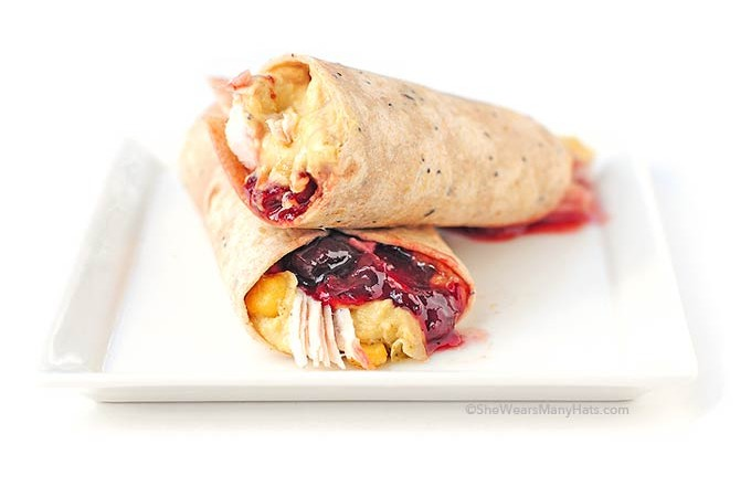 These Rosemary Hummus Turkey Cranberry Wraps are like Thanksgiving dinner all wrapped up in a tasty little package.